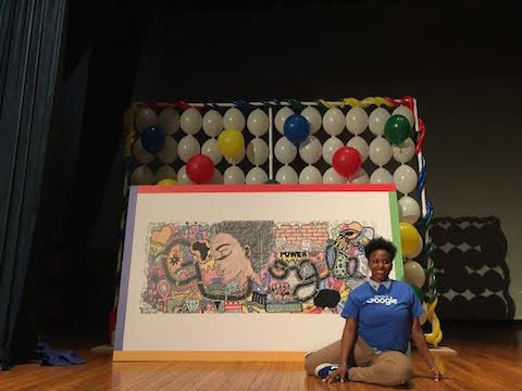 Akilah Johnson posing in front of her My Afrocentric Life work that won 2016 Google Doodle Contest  (Source: Google)