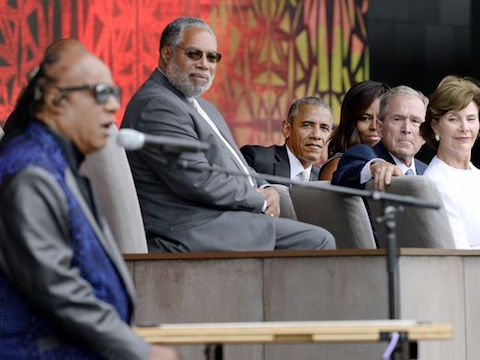 President Obama and Bush listen to Stevie Wonder's  music during the dedication ceremony of  Smithsonian African American History and Culture Museum in DC on Sep 24, 2016