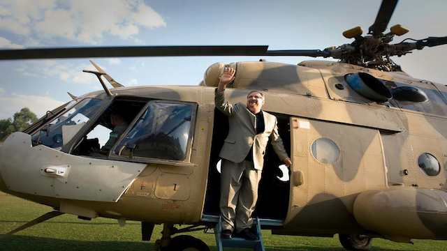 Pastor Rick Warren, flying in a Rwandan military helicopter  2013, when he was still wanted