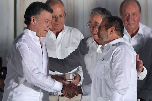 FARC leader Timochenko  and Colombia President Santos shake hands at the Peace agreement ceremony in Cuba in Sept. 2016