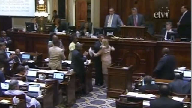 South Carolina Rep Jenny Horne hugs Representatives after asking  the House to take the Confederate flag down