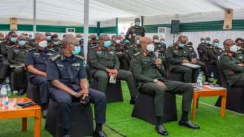 Front row, from left: Gen Dan Munyuza, Jean Bosco Kazura and Fred Ibingira in a meeting in early  April 2021